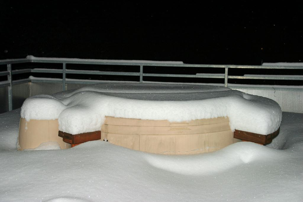 snow caps on our Softub hot tub