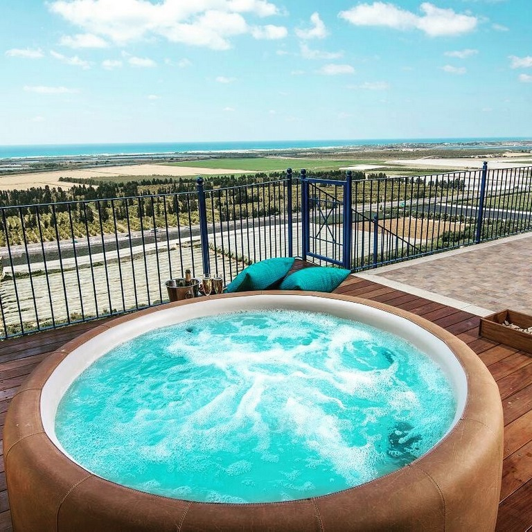 Softub hot tub with balcony view