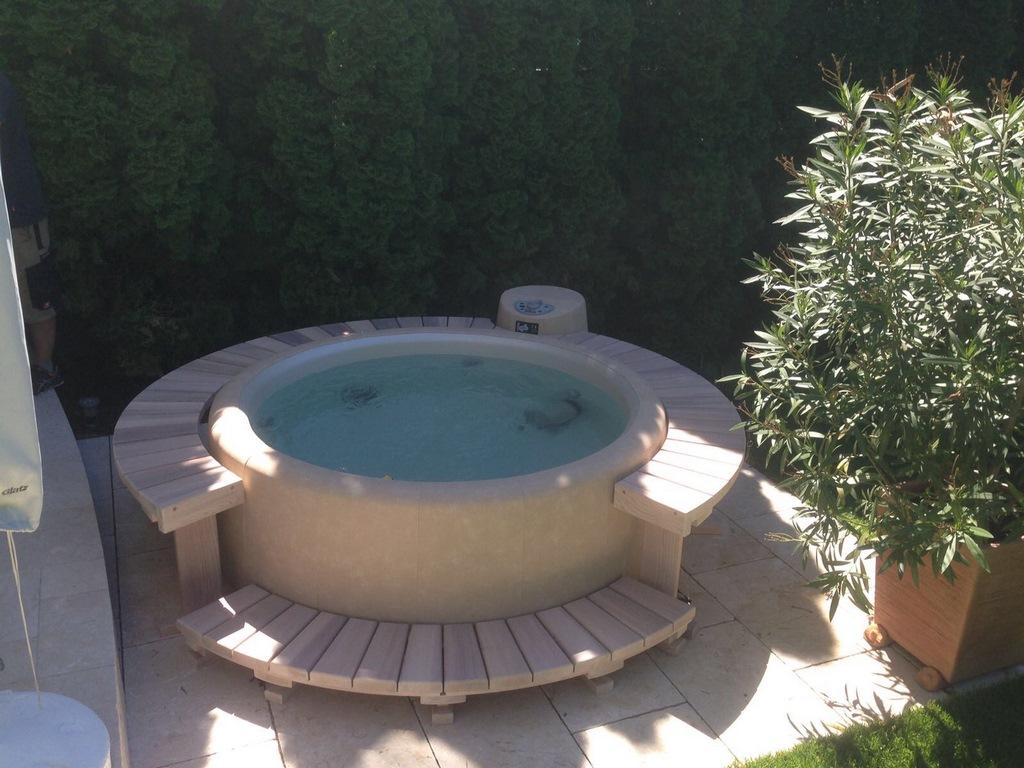 Softub hot tub in almond and cedar surround