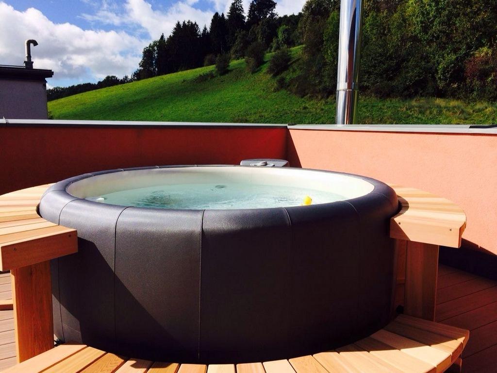 Softub hot tub with cedar surround